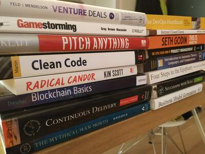 A pile of books about programming, management and business